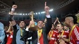 Cacau (Kairat Almaty coach) celebrates with the cup